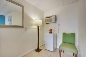 ac unit mini fridge lamp green chair